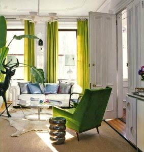A nice addition of color with curtains and a pop of green with the chair