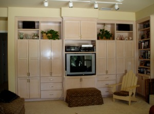 white washed cabinets, built-in tv